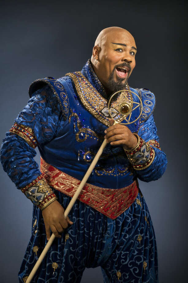 "This undated image released by Disney Theatrical Productions shows James Monroe Iglehart as the Genie from the musical ""Aladdin."" As the fast-talking Genie in Disney Theatrical Group's latest Broadway extravaganza, Iglehart is taking a different tact than his hero Robin Williams did in the 1992 animated ""Aladdin."" Iglehart is channeling some smooth cool from bandleader Cab Calloway and ragtime entertainer Fats Waller. The creative team has urged him to make the role his own, and he has, adding things like a series of friendly fist-bumps between him and Aladdin. He's also learned to tap dance. (AP Photo/Disney Theatrical Productions, Cylla von Tiedemann)"