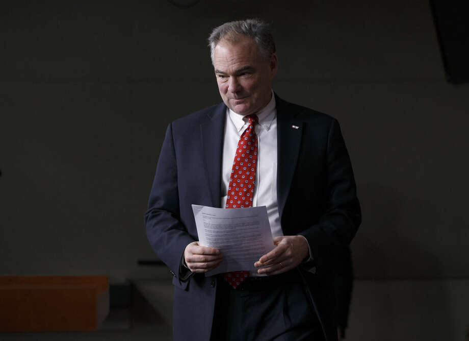 FILE - In this Feb. 11, 2015, file photo, Sen. Tim Kaine, D-Va., arrives for a news conference on President Barack Obama's request to Congress to authorize military force against Islamic State fighters at the Capitol in Washington. Republicans now in charge in Congress offer their budget blueprint the week of March 16 with the pledge to balance the nation's budget within a decade and rein in major programs such as food stamps and Medicare. More pressing for many Republicans, however, is easing automatic budget cuts set to slam the military. (AP Photo/J. Scott Applewhite, File)