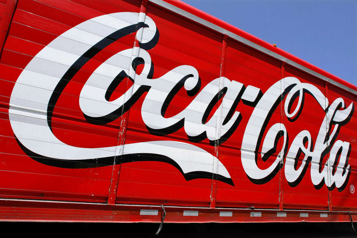 This Monday, June 25, 2012 photo shows the Coca-Cola logo on the side of a delivery truck in Springfield, Ill. Coca-Cola, the world's biggest beverage maker, is working with fitness and nutrition experts who suggest its cola as a healthy treat. (AP Photo/Seth Perlman)