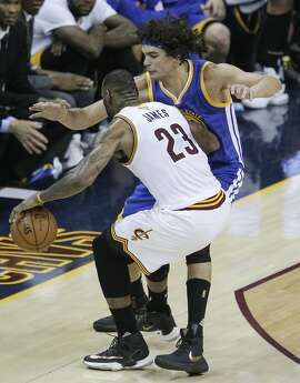 Golden State Warriors' Anderson Varejao guards Cleveland Cavaliers' LeBron James in the third quarter during Game 4 of the NBA Finals at The Quicken Loans Arena on Friday, June 10, 2016 in Cleveland, Ohio.