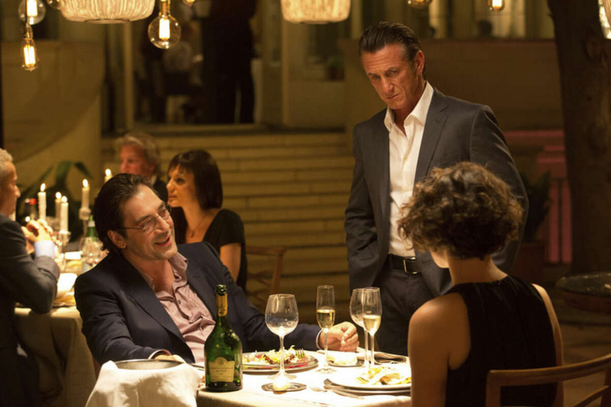 """This photo provided by Open Road Films shows, from left, Javier Bardem as Felix, Sean Penn as Jim Terrier and Jasmine Trinca as Annie in a scene from the film, """"The Gunman,"""" opening in theaters on Friday, March 20, 2015. (AP Photo/Open Road Films, Keith Bernstein)"""
