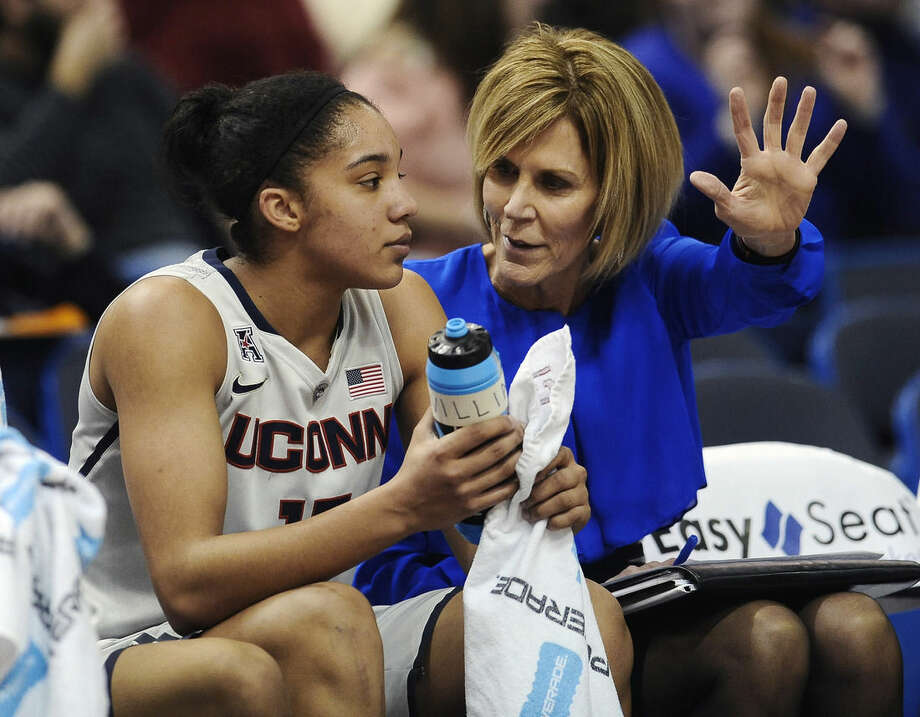 FILE - In this Jan. 28, 2015, file photo, associate head coach Chris Dailey, right, talks with Connecticut's Gabby Williams, left, during the first half of an NCAA college basketball game in Hartford, Conn. Dailey has turned down numerous head coaching opportunities to remain Geno Auriemma's assistant at UConn for 30 years. (AP Photo/Jessica Hill, File)