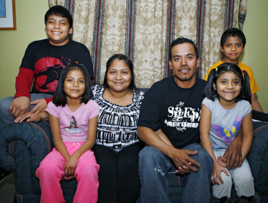 "This photo taken Feb. 6, 2014, shows Abel Bautista and his wife Guadalupe posing with their four children at their home in Thornton, Colo. From left are, Kolby, 12, Wendy, 8, Guadalupe, 32, Able, 37, Kimbereli, 7, and Able, 10. Abel Bautista and his wife entered the U.S. illegally decades ago, and have been fighting deportation ever since a traffic stop in September of 2012. Their next hearing is in October and Bautista is hoping for action from DC. Citizenship is far from his mind.""We're just left dangling,"" Bautista said. ""It's better for each person to have citizenship, but first stop the deportations, because it's affecting so many families."" (AP Photo /Ed Andrieski)"