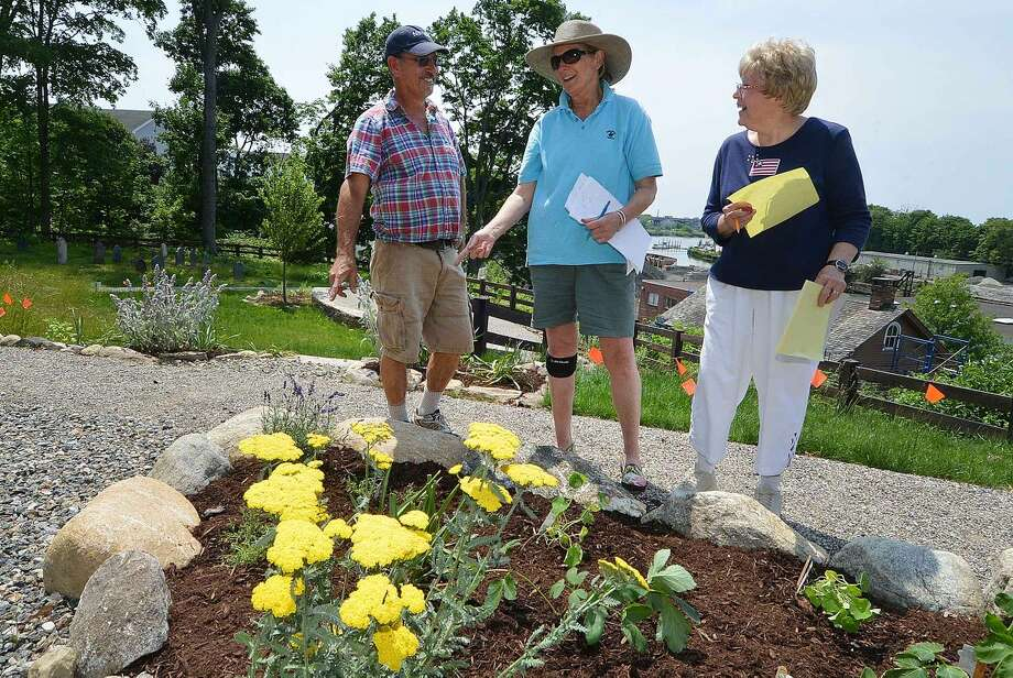 Hour Photo/Alex von KleydorffIn this file photo, Michael Mushak, Jan Broome and Joanne Hughes look over the finished Colonial Herb garden at Mill Hill Historic Park