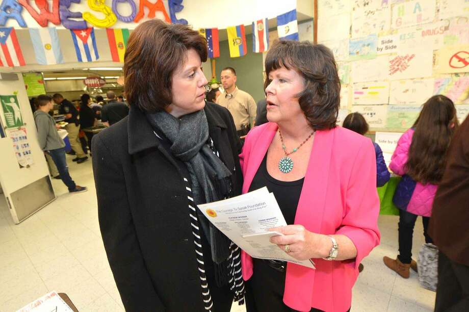 Hour Photo/Alex von Kleydorff Sonya Finch wife of Bridgeport Mayor Bill Finch and Ginger Katz talk about the progra during the Courage to Speak Family Night Program at West Rocks School