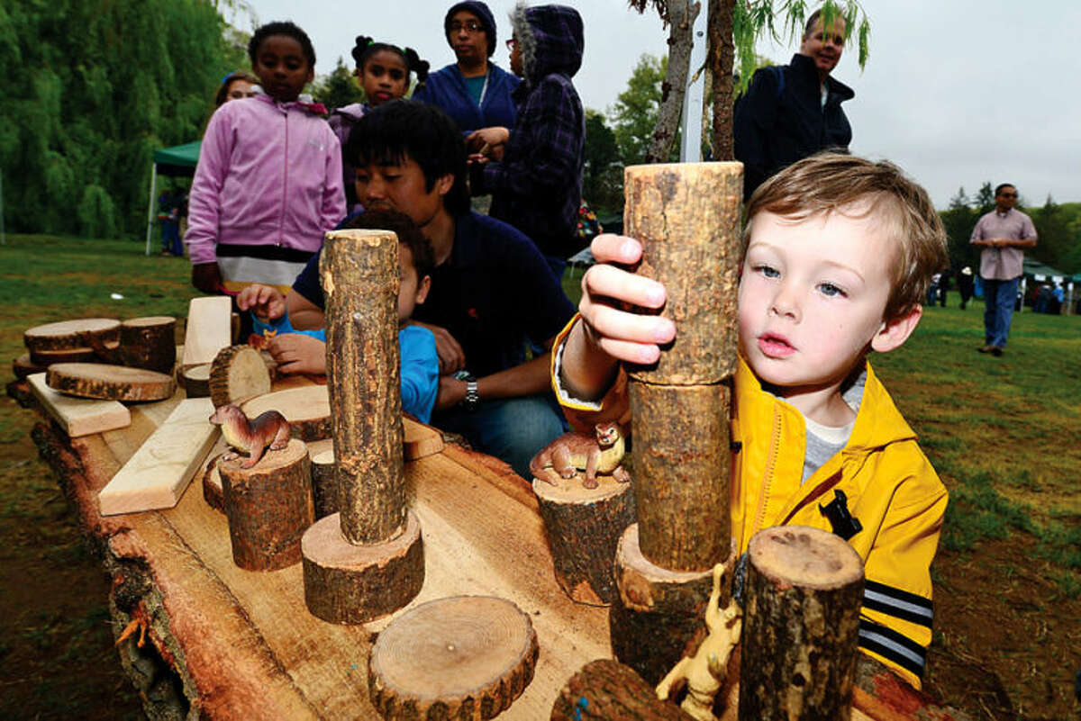 Brian O'Gorman builds with logs from the Westport Tree Alliance at The 7th annual Norwalk Wilton Tree Festival at Cranbury park Saturday. Hour photo / Erik Trautmann