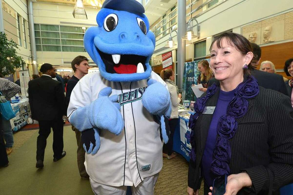 Hour Photo/Alex von Kleydorff BB The Bluefish stops for a moment with Darien Chamber of Commerce President Carol Wilder - Tamme during The Greater Norwalk Chamber of Commerce Multi-Chamber Expo and Networking Event at NCC