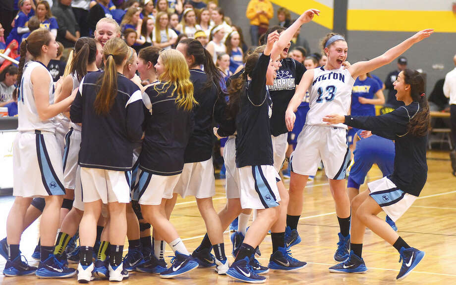 The Wilton girls basketball team celebrates its 55-54 win over Mercy in the Class LL semifinals on Monday in Milford.