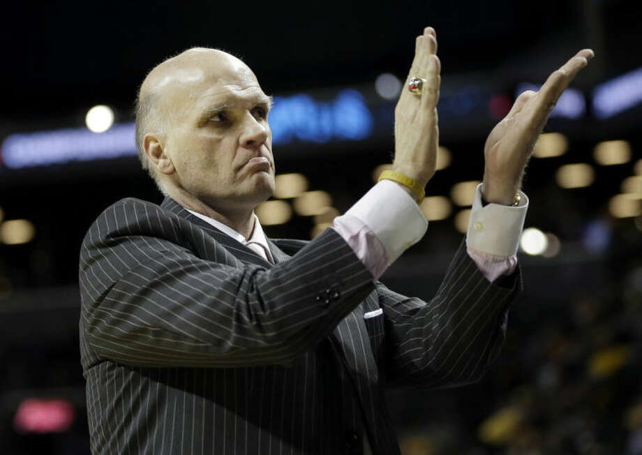 Saint Joseph head coach Phil Martelli recognizes the crowd during the second half of an NCAA college basketball game against St. Bonaventure in the semifinal round of the Atlantic 10 Conference tournament at the Barclays Center in New York, Saturday, March 15, 2014. Saint Joseph's defeated St. Bonaventure 67-48. (AP Photo/Seth Wenig)
