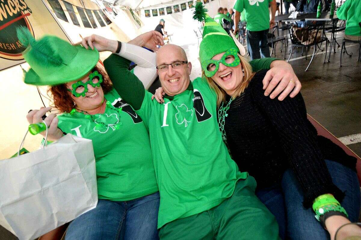 Hour Photo/Alex von Kleydorff Owner Ollie O'Neill drops in on friends Shelly Grace and Suzanne Collins during St. Patricks Day at O'Neill's Pub and Restaurant in Sono