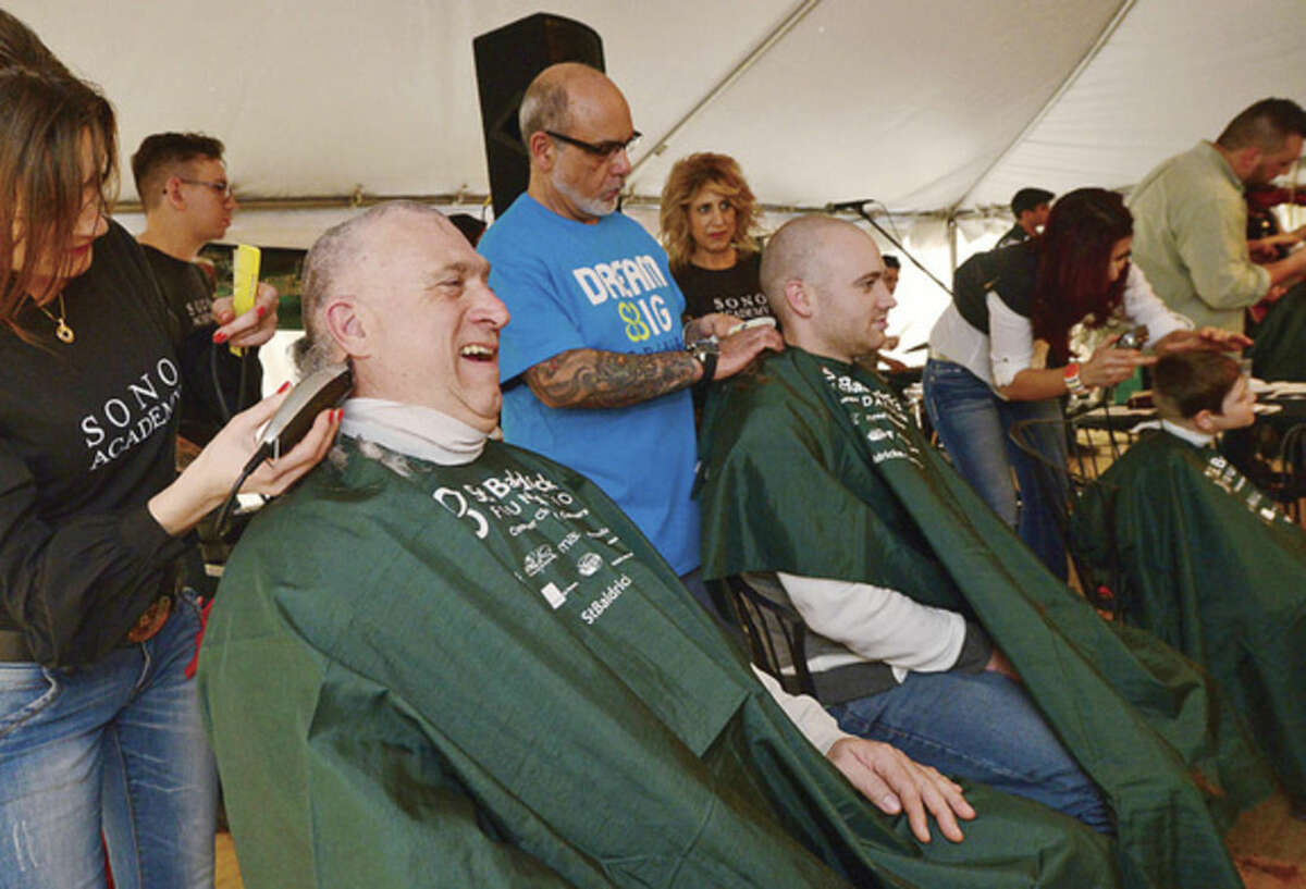 Hour photo / Erik Trautmann - Mike Sharpe gets his head shaved as he participates in St. Baldrick's Foundation's signature head-shaving event to raise funds and awareness for lifesaving childhood cancer research at O'Neill's Irish Pub on Saturday.