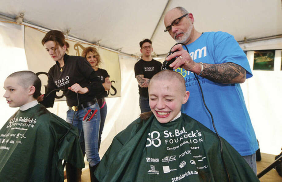 Hour photo / Erik Trautmann - Nick Wert gets his head shaved to raise money for cancer research. O'Neill's Irish Pub in Norwalk sponsored a St. Baldrick's Foundation signature head-shaving event to raise funds and awareness for lifesaving childhood cancer research on Saturday.