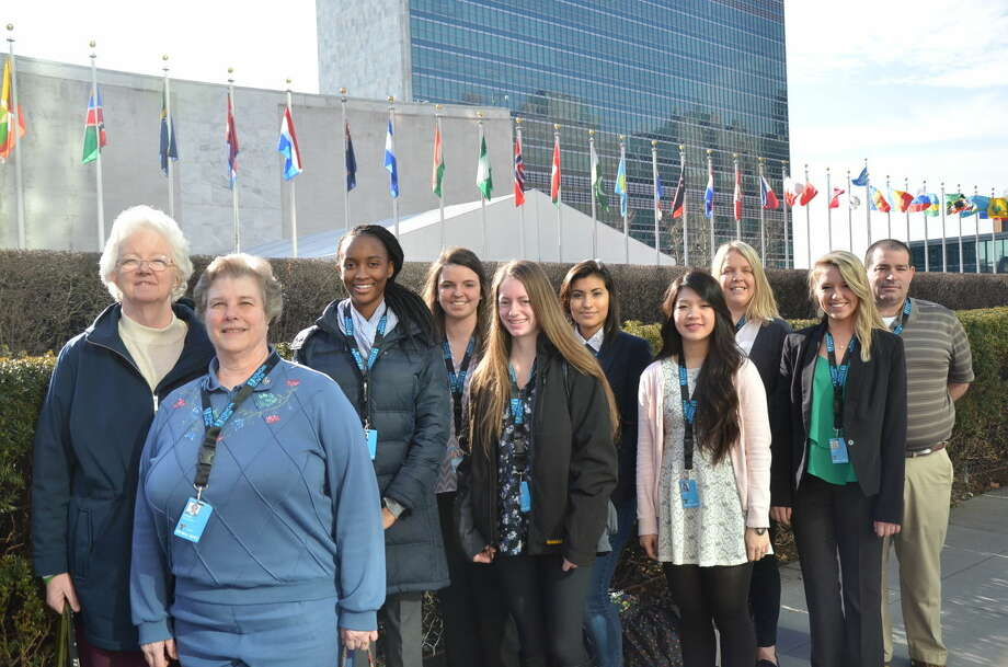 from left: Sister Eileen Reilly, SSND UN-NGO representative; Sister Kathy Jager, teacher at Institute of Notre Dame (IND); Micayla Wilson, IND student; Caitlyn Lowry, student at Notre Dame High School (NDHS); Corey Fletcher, IND student; Mariajose Ortiz, NDHS student; Linda Pham, NDHS student; Sandy Wilson, NDHS staff; Allison Moser, NDHS student; and Anthony Smith, NDHS teacher.