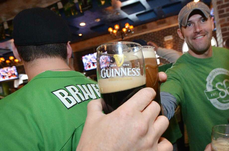 Hour Photo/Alex von Kleydorff Cheers as Norwalk's Bravest enjoys St. patricks day at O'Neill's Pub in Sono