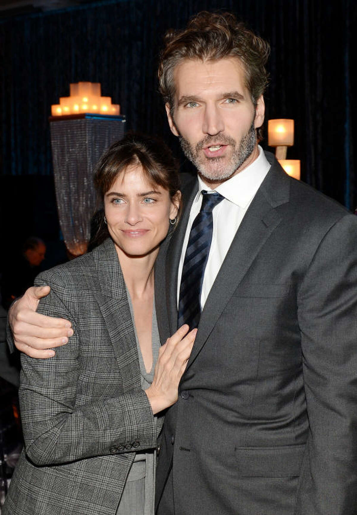"""Actress Amanda Peet with husband creator and executive producer David Benioff attend HBO's """"Game of Thrones"""" fourth season premiere party at the Museum of Natural History on Tuesday, March 18, 2014 in New York. (Photo by Evan Agostini/Invision/AP)"""