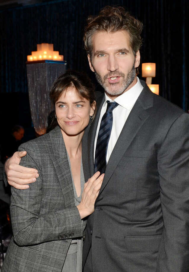 "Actress Amanda Peet with husband creator and executive producer David Benioff attend HBO's ""Game of Thrones"" fourth season premiere party at the Museum of Natural History on Tuesday, March 18, 2014 in New York. (Photo by Evan Agostini/Invision/AP)"