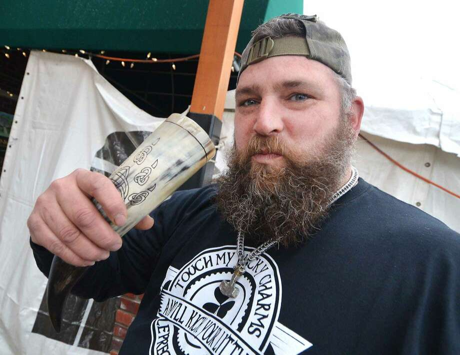 Hour Photo/Alex von Kleydorff Kyle Weimar has a cold Guinness from his drinking horn during St. Patricks day at O'Neill's Pub