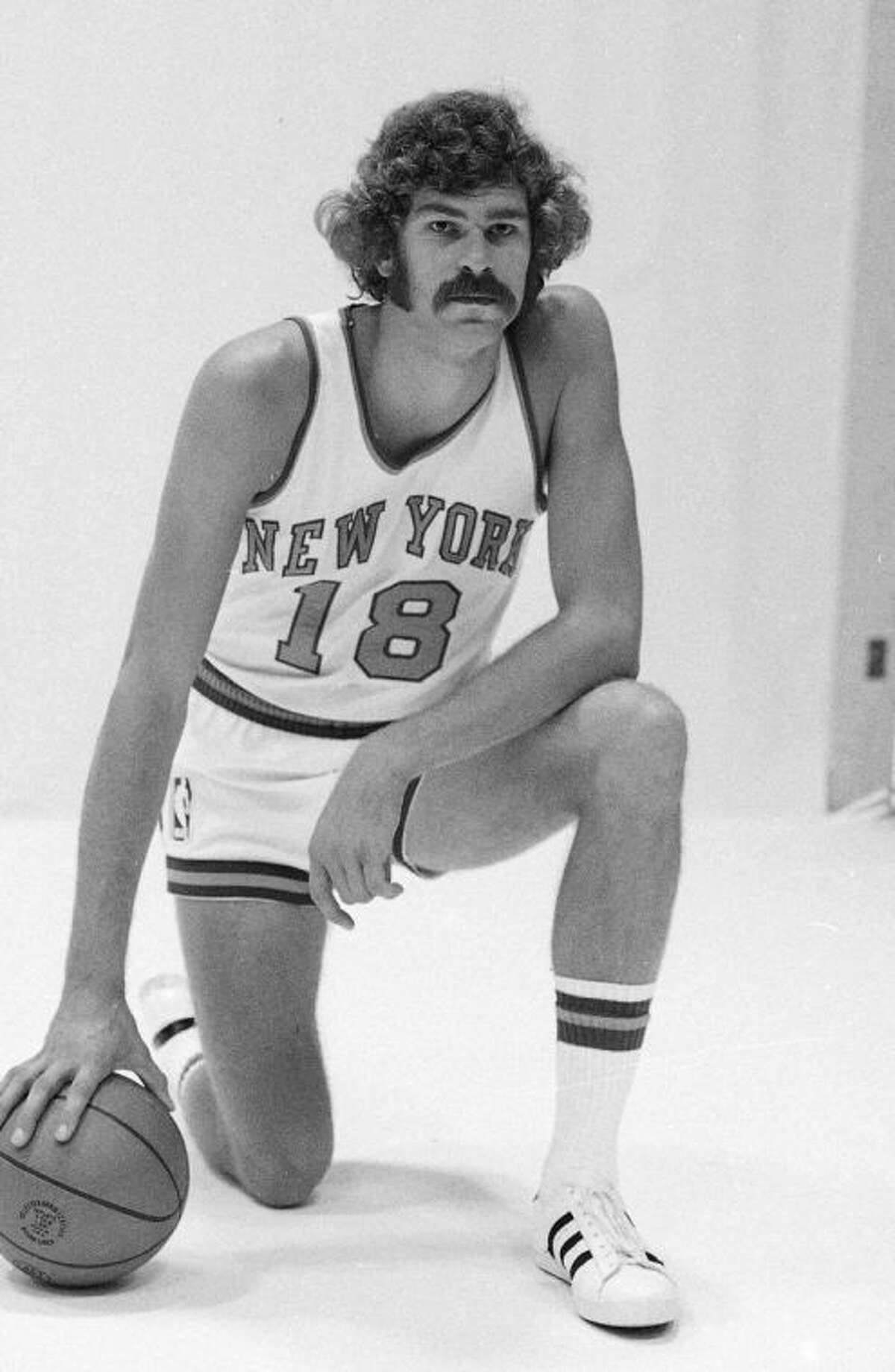 """FILE - In this 1971 file photo, New York Knicks' Phil Jackson poses for a photo. Jackson has returned to the New York Knicks as their team president. The Knicks announced Jackson's hiring Tuesday, March 18, 2014, at a news conference in the lobby of Madison Square Garden, where a giant sign reading """"Welcome Home Phil"""" was overhead and shirts with the No. 18 Jackson wore as a player lined the racks in the merchandise store. (AP Photo/File)"""