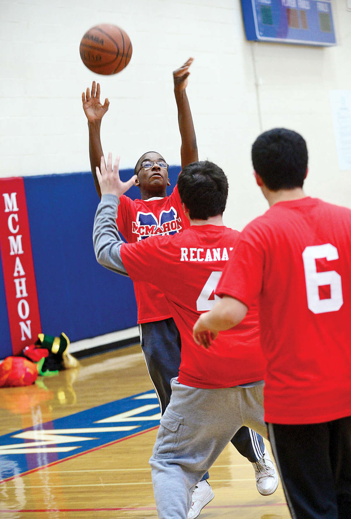 Hour photo / Erik Trautmann Ralph Laguerre shoots during Brien McMahon High School's new Unified Sports Team basketball prcatice Tuesday.