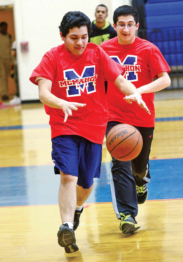 Hour photo / Erik Trautmann Nicanor Gomez dribble down court during Brien McMahon High School's new Unified Sports Team practice Tuesday.