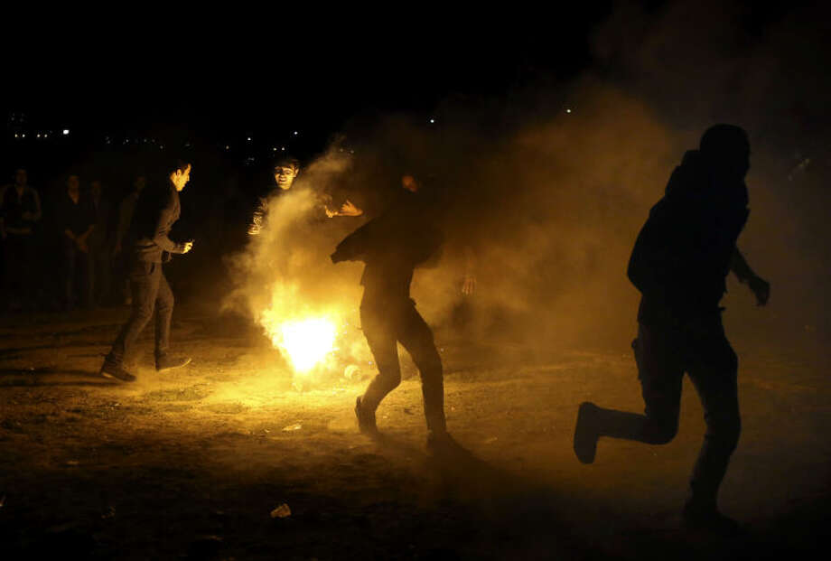 "In this picture taken on Tuesday, March 18, 2014, Iranian young adults jump over a bonfire during a celebration, known as ""Chaharshanbe Souri,"" or Wednesday Feast, marking the eve of the last Wednesday of the solar Persian year, in Pardisan park, Tehran, Iran. The festival has been frowned upon by hard-liners since the 1979 Islamic revolution because they consider it a symbol of Zoroastrianism, one of Iran's ancient religions of Iranians. They say it goes against Islamic traditions. (AP Photo/Vahid Salemi)"