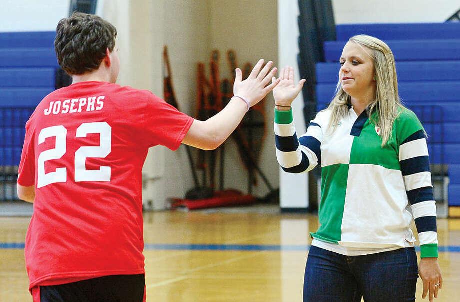 Hour photo / Erik Trautmann Haed coach Kelsey Murphy congratulates Matthew Josephs during Brein McM