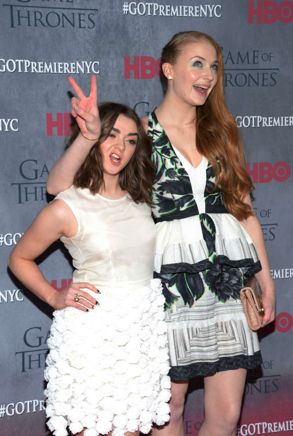 """Maisie Williams and Sophie Turner arrive at New York Premiere of """"Game of Thrones"""" Fourth Season on Tuesday, March 18, 2014, in New York. (Photo by Evan Agostini/Invision/AP)"""