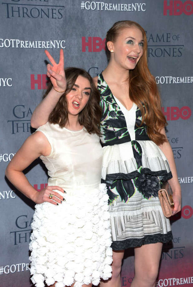 "Maisie Williams and Sophie Turner arrive at New York Premiere of ""Game of Thrones"" Fourth Season on Tuesday, March 18, 2014, in New York. (Photo by Evan Agostini/Invision/AP)"
