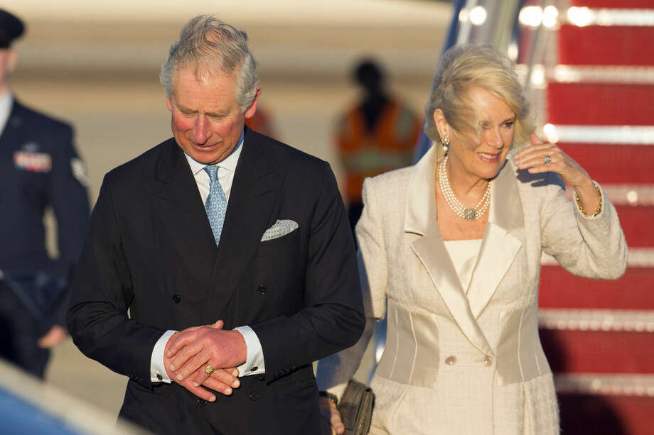 Britain's Prince Charles and the Duchess of Cornwall, arrive at Andrews Air Force Base, on Tuesday, March 17, 2015, in Andrews Air Force Base, Md. The couple is scheduled to visit cultural and educational sites over the next three days. (AP Photo/ Evan Vucci)