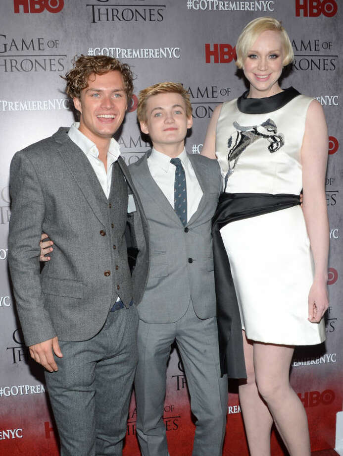 "Cast members Finn Jones, left, Jack Gleeson and Gwendoline Christie attend HBO's ""Game of Thrones"" fourth season premiere at Avery Fisher Hall on Tuesday, March 18, 2014 in New York. (Photo by Evan Agostini/Invision/AP)"