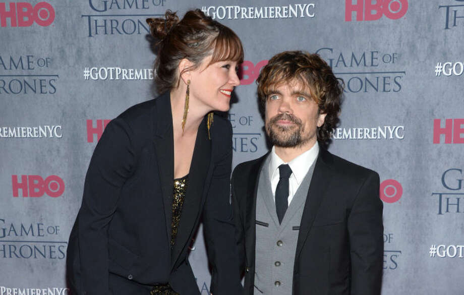 "Peter Dinklage, right, and Erica Schmidt arrive at New York Premiere of ""Game of Thrones"" Fourth Season on Tuesday, March 18, 2014, in New York. (Photo by Evan Agostini/Invision/AP)"