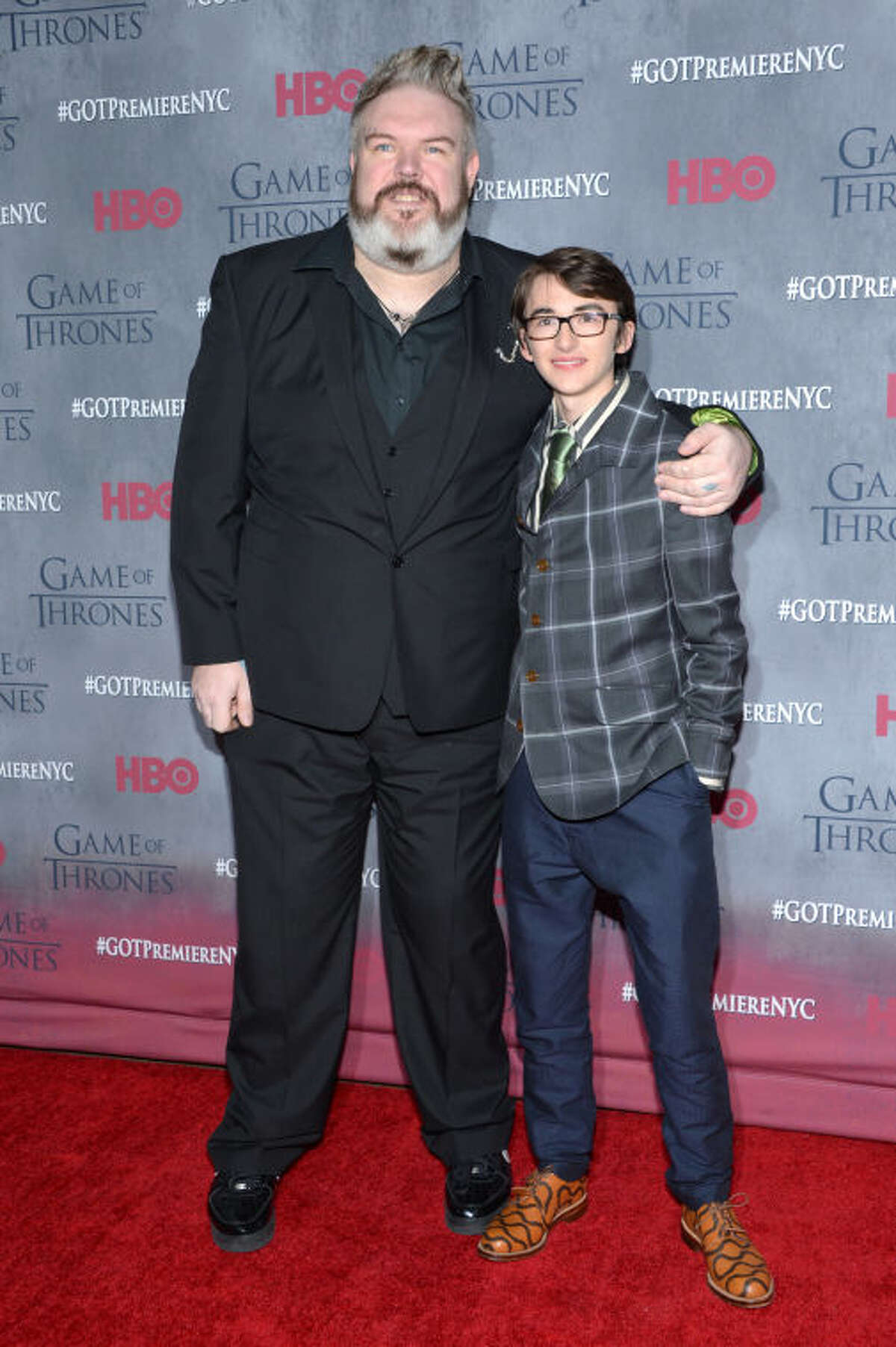 """Kristian Nairn and Isaac Hempstead Wright arrive at New York Premiere of """"Game of Thrones"""" Fourth Season on Tuesday, March 18, 2014, in New York. (Photo by Evan Agostini/Invision/AP)"""