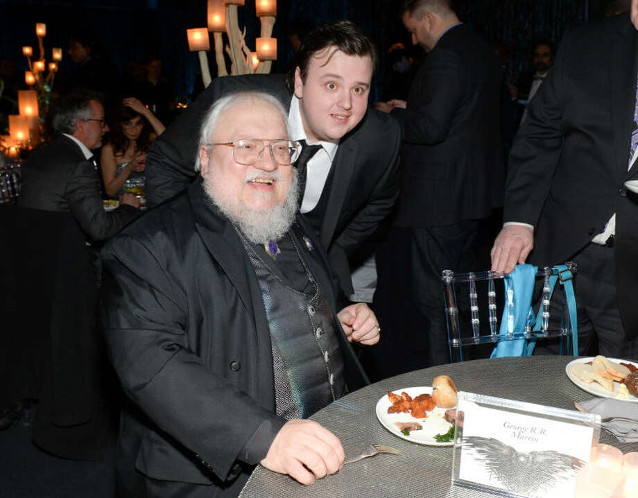 "Author and co-executive producer George R.R. Martin, left, and actor John Bradley attend HBO's ""Game of Thrones"" fourth season premiere after party at the Museum of Natural History on Tuesday, March 18, 2014 in New York. (Photo by Evan Agostini/Invision/AP)"