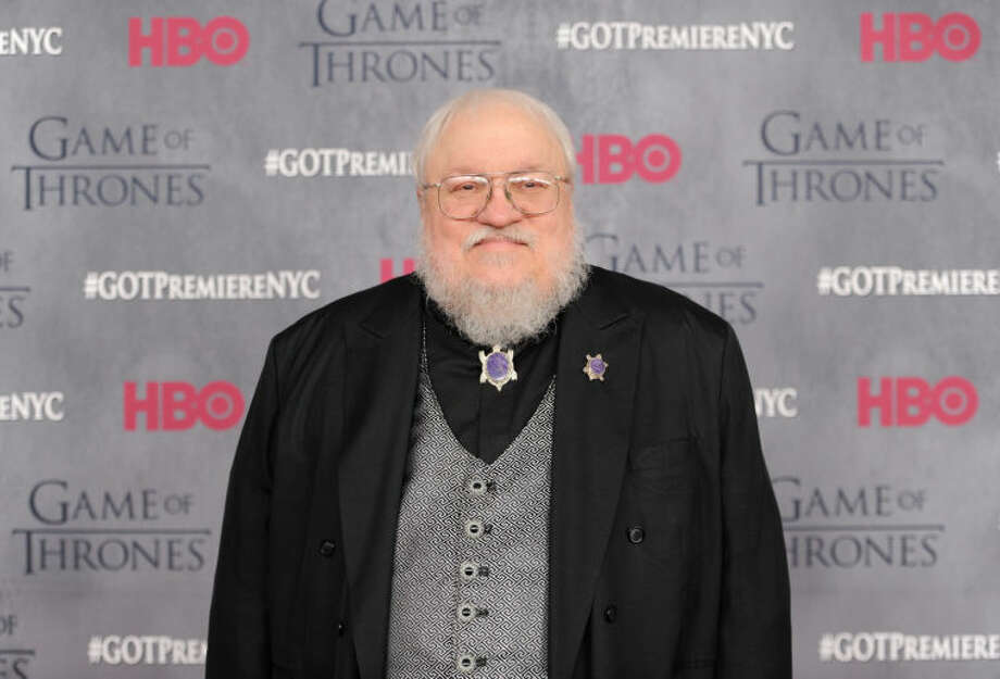 "Author and co-executive producer George R. R. Martin attends HBO's ""Game of Thrones"" fourth season premiere at Avery Fisher Hall on Tuesday, March 18, 2014 in New York. (Photo by Evan Agostini/Invision/AP)"