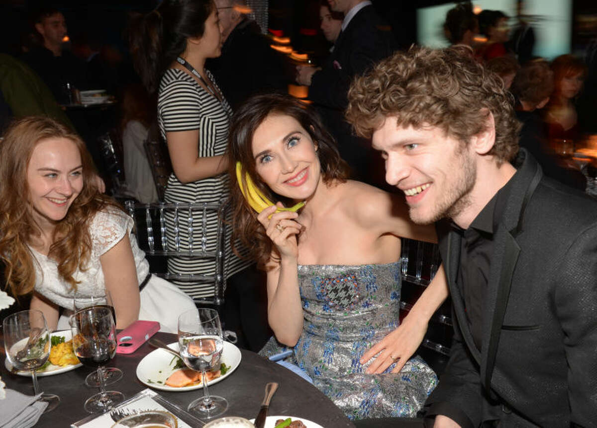 """Actress Carice van Houten, center, and friends attend HBO's """"Game of Thrones"""" fourth season premiere after party at the Museum of Natural History on Tuesday, March 18, 2014 in New York. (Photo by Evan Agostini/Invision/AP)"""