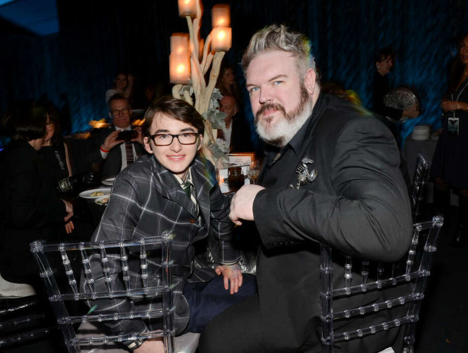"""Actors Isaac Hempstead Wright, left, and Kristian Naim attend HBO's """"Game of Thrones"""" fourth season premiere after party at the Museum of Natural History on Tuesday, March 18, 2014 in New York. (Photo by Evan Agostini/Invision/AP)"""