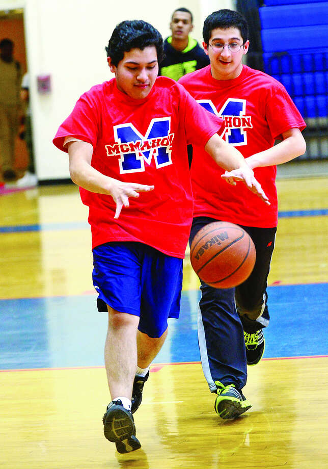 Nicanor Gomez dribble down court during Brien McMahon High School's new Unified Sports Team practice Tuesday. (Hour photo / Erik Trautmann)