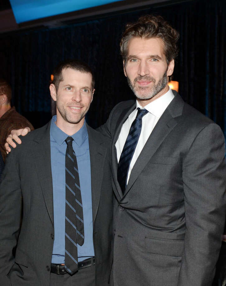 """Co-creators and executive producers Dan Weiss, left, and David Benioff attend HBO's """"Game of Thrones"""" fourth season premiere after party at the Museum of Natural History on Tuesday, March 18, 2014 in New York. (Photo by Evan Agostini/Invision/AP)"""