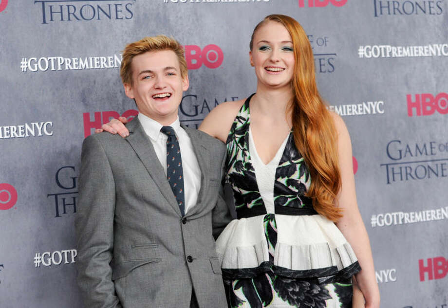 "Actors Jack Gleeson and Sophie Turner attend HBO's ""Game of Thrones"" fourth season premiere at Avery Fisher Hall on Tuesday, March 18, 2014 in New York. (Photo by Evan Agostini/Invision/AP)"