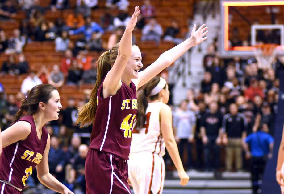 Hour photo/John Nash - St. Joe's Jacqueline Jozefick reacts to the final buzzer as she looks to the bench after her team's 50-44 state Class M championship win over Cromwell on Saturday at the Mohegan Sun Arena.