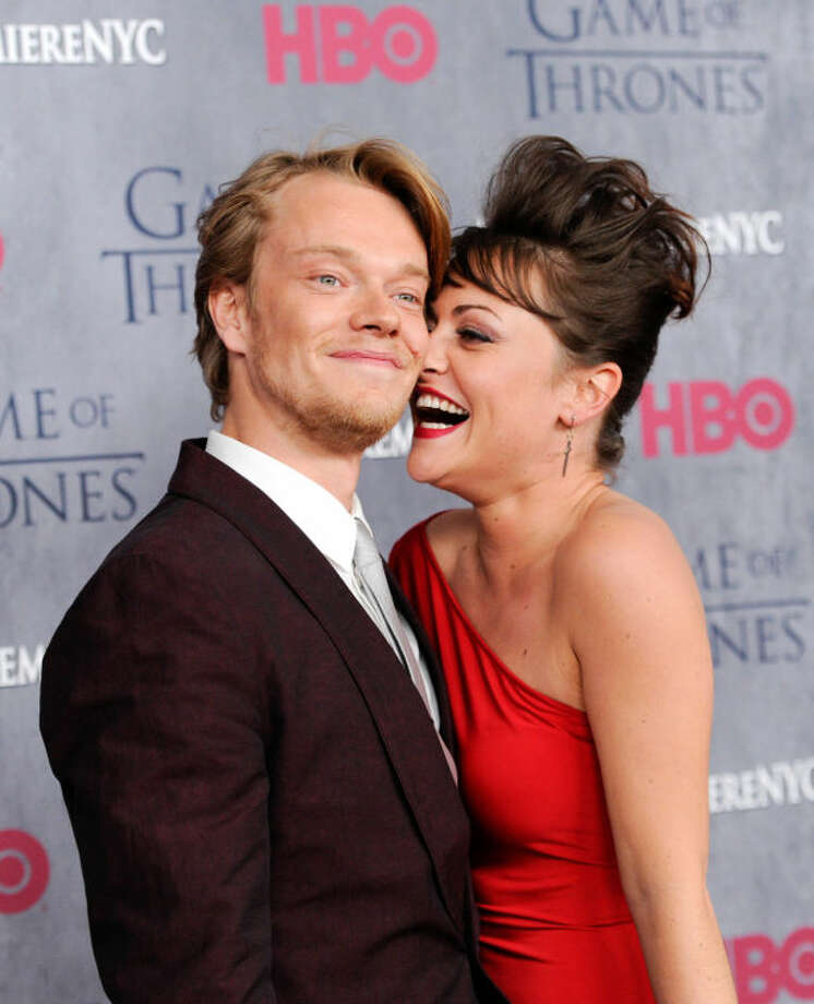 "Actor Alfie Allen and fiancé Jaime Winstone attend HBO's ""Game of Thrones"" fourth season premiere at Avery Fisher Hall on Tuesday, March 18, 2014 in New York. (Photo by Evan Agostini/Invision/AP)"