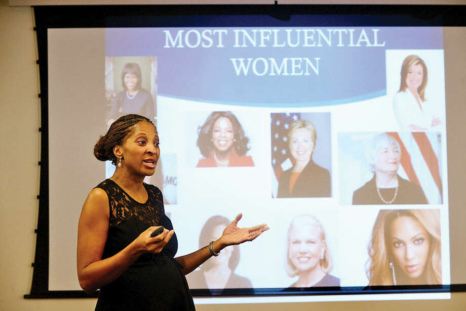 """Hour photo / Erik Trautmann Empowering Coach, Simone Morris, points to influential women such as Oprah Winfrey, Sheryl Sandberg, and Arianna Huffington, and the lessons they impart, during her presentation Saturday during a celebration of Women's History Month as part of the South Norwalk Branch Library's """"Let's Talk @SoNo"""" series."""