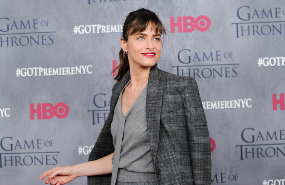 "Actress Amanda Peet attends HBO's ""Game of Thrones"" fourth season premiere at Avery Fisher Hall on Tuesday, March 18, 2014 in New York. (Photo by Evan Agostini/Invision/AP)"