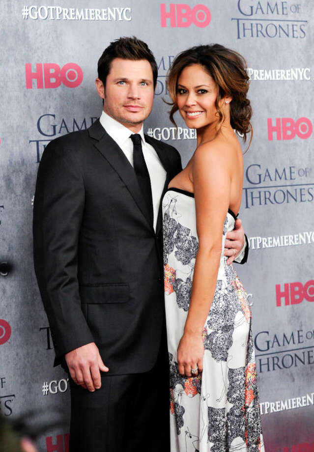 "Television personalities Nick Lachey and wife Vanessa Lachey attend HBO's ""Game of Thrones"" fourth season premiere at Avery Fisher Hall on Tuesday, March 18, 2014 in New York. (Photo by Evan Agostini/Invision/AP)"