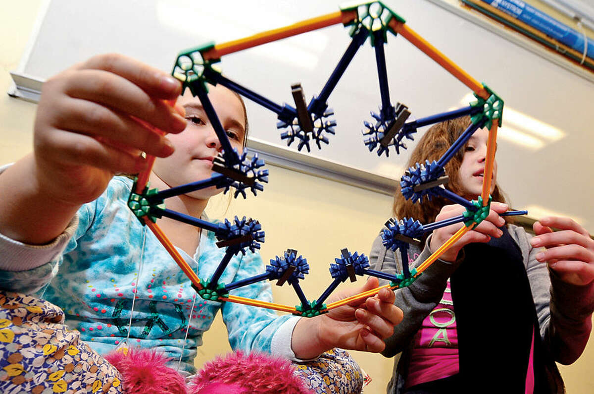Hour photo / Erik Trautmann Sarah Zucker and Vicky Tsiranides put together a K'Nex ferris wheel as the Norwalk Community College Extended Studies Division hosts The Amazing Girl Science Conference: Amusement Park Physics event for girls grades 4 to 8 Saturday at the college's East Campus. The Amusement Park Experience, part of the Saturday Academy for Girls, and the NCC College for Kids Program, provided students an opportunity to combine real-world applications with STEM concepts.
