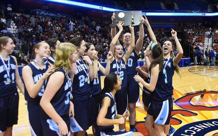 Hour photo/John Nash - The Wilton girls basketball team celebrates its 2015 Class LL state championship at the Mohegan Sun Arena.
