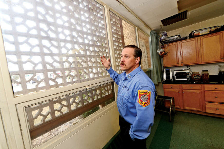 Hour photo / Erik Trautmann Norwalk Fire Captain Michel McCallum talks about what improvements will be made in renovations to Broad River Station No. 1 at 90 New Canaan Ave. later this year. Reallocation of $934,000 leftover from new headquarters construction will pay for the work.