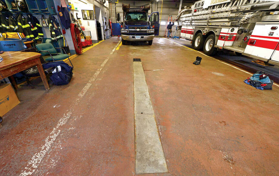 Hour photo / Erik Trautmann . Norwalk fire captain Michel McCallum talks about what improvements will be made in upcoming renovations. Norwalk Fire Department to renovate Broad River Station No. 1 at 90 New Canaan Ave. later this year. Reallocation of $934,000 leftover from new headquarters construction will pay for the work.