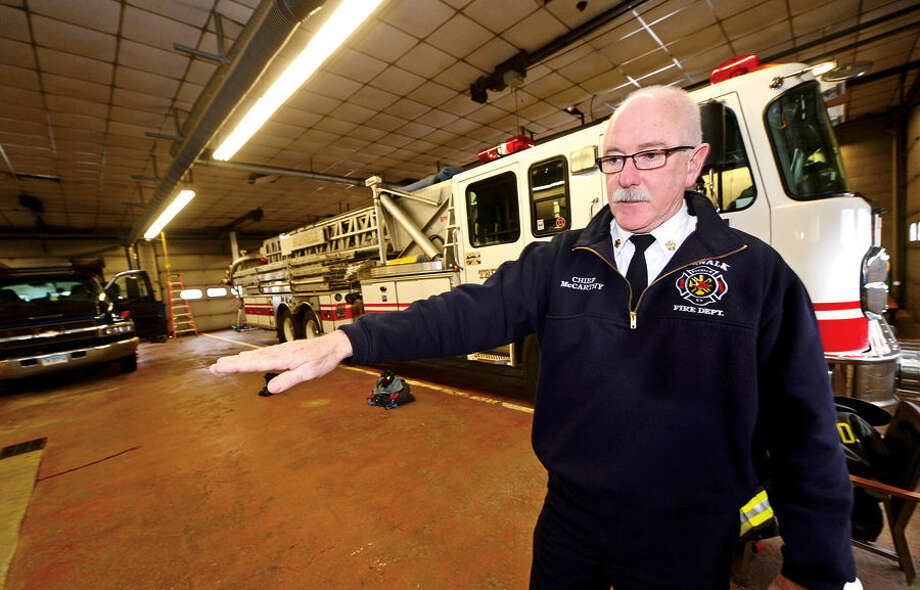 Hour photo / Erik Trautmann Norwalk Fire Chief Denis McCarthy talks about what improvements will be made in renovations to Broad River Station No. 1 at 90 New Canaan Ave. later this year. Reallocation of $934,000 leftover from new headquarters construction will pay for the work.
