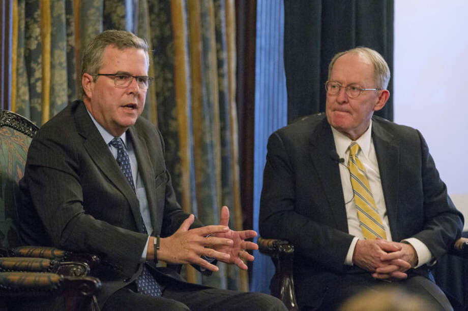 Former Florida Gov. Jeb Bush, left, speaks at an education forum U.S. Sen. Lamar Alexander, R-Tenn., in Nashville, Tenn., on Wednesday, March 19, 2014. Bush urged politicians to make the case to their constituents in favor of Common Core education standards. (AP Photos/Erik Schelzig)